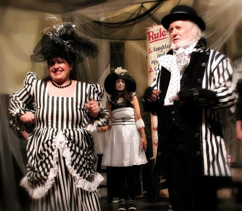 Angela Conzone Dwyer as Mrs. Zizzlebot, Jennifer Ann as FlipFlop, and Richard O'Donnell as Belvedere Brumbleton in Brazillia R. Kreep's Alice Isn't All There'