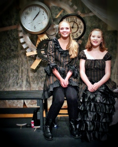 Our contemporary Alice is played by Elizabeth Peo and the original Victorian Alice is played by Hailey Weber.