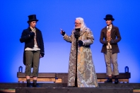 Cadence Payne as Nipper and Jillian Lebel as Cager confront R. O'Donnell as Scrooge in the musical comedy MR. SCROOGE